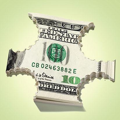 na zdjęciu jest plik banknotów 10 dolarowych z obgryzionymi rogami