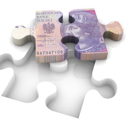 zdjęcie przedstawia puzzla z nadrukiem banknotu dzwudziestozłotowego