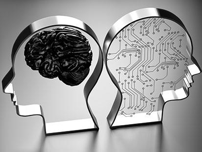 na zdjęciu są dwie głowy zrobione z metalu, odwrócone do siebie z czego w jednej jest mózg a w drugiej są obwody drukowane