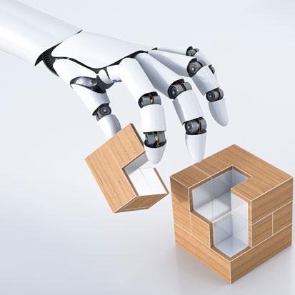 na zdjęciu jest dłoń robota układająca klocka