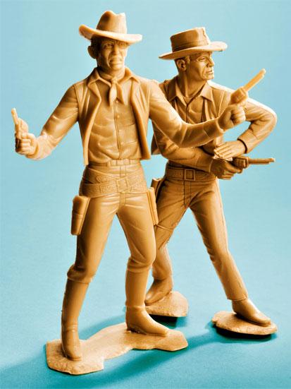 na zdjęciu są dwaj kowboje z pistoltami zrobieni z wosku