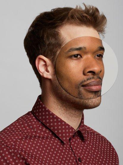 na zdjęciu twarz białego mężczyznny z wmontowaną cześcia twarzy czarnoskórego mężczyzne